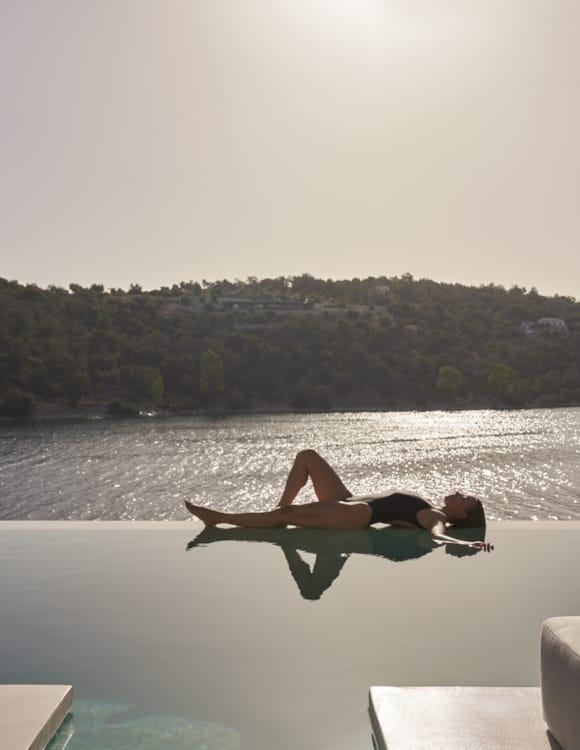 girl-lying-by-the-pool-drz_azur-retreat-ii_0199